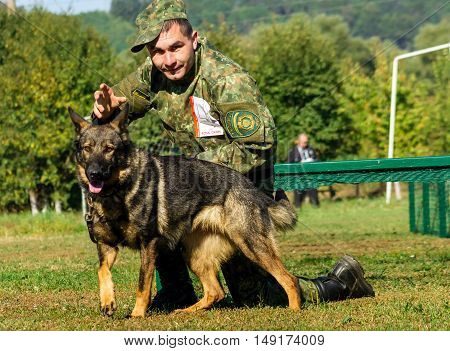Mukachevo Ukraine - September 27. 2016: Canine with his dog overcomes obstacles band during the first championship of the National Police of Ukraine with all-around dog handlers.