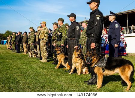 Mukachevo Ukraine - September 27. 2016: Dog handlers with their dogs during the first championship of the National Police of Ukraine with all-around dog handlers.