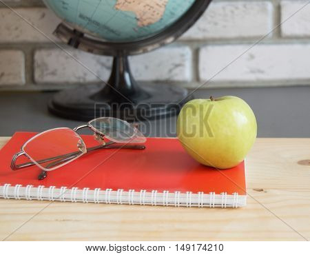 World teachers ' Day in school. Still life with books, globe, Apple, glasses selective focus.