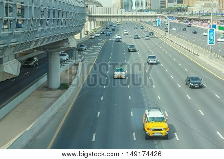 Dubai, United Arab Emirates - May 2, 2013: traffic on Sheikh Zayed Road, highway E 11, which runs through Dubai and is home to the most modern skyscrapers located in the Dubai Downtown district.