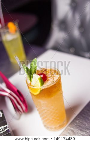 an alcoholic cocktails is in beautiful glass in the restaurant