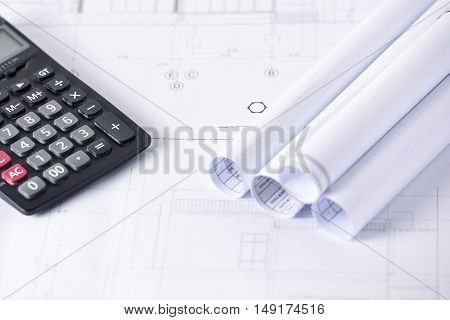 Engineer Calculate cost architectural building project on architectural blueprint