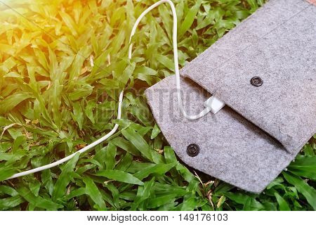 charging device with power bank on green grass