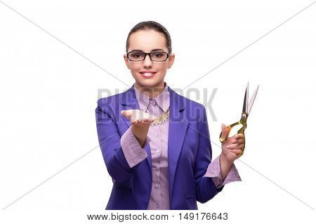 Young woman with scissors isolated on white