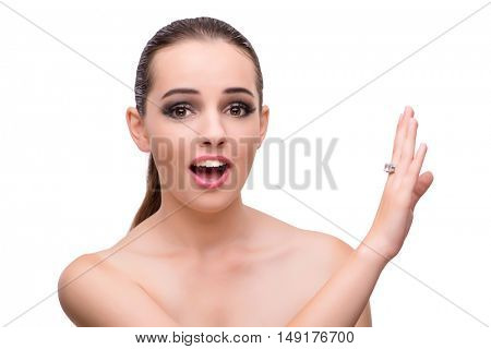 Young woman with engagement ring isolated on white