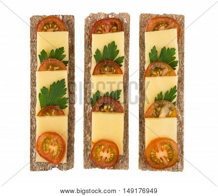 Row Of Crisp Bread With Cheese, Cucumbers And Tomatoes