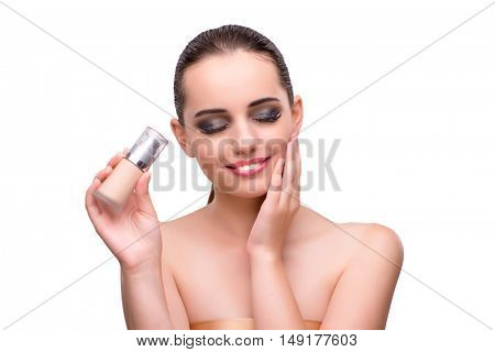 Woman with bottle of cream isolated on white