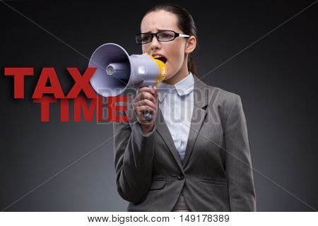 Businesswoman in business tax concept