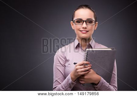 Businesswoman with notebook in business concept