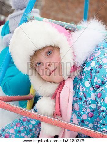 closeup portrait of Happy laughing girl in winter clothes outside playing in the snow drifts in the winter Russia, - Moscow - February 25, 2016