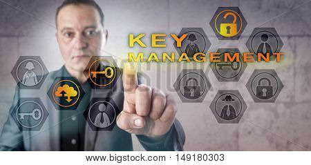 Security administrator with tense look is activating KEY MANAGEMENT on a virtual screen. Information technology and data security concept for the creating exchange and storage of cryptographic keys.