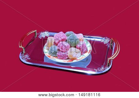 Hill multicolored fruit jelly slices on a beautiful diarrhea.