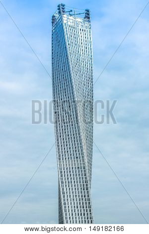 Dubai, UAE - May 2, 2013: Cayan Tower, or Infinity Tower, is a tower or spiral skyscraper located in Dubai Marina skyline. The Cayan Tower is the tallest building in the world with a twist of 90.