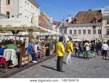 TALLINN, ESTONIA - AUGUST 01, 2015: Summer sunny day on the town hall square. Tourist landmark of the city Tallinn