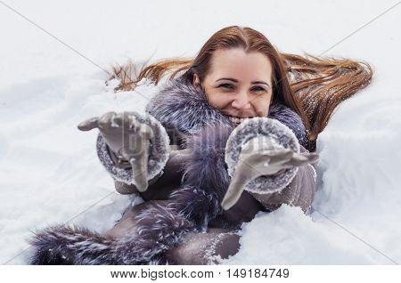 Beautiful woman having fun on winter walk