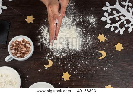ready for dough by hands on wooden table background