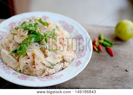 Thai glass noodles marinate with pork, lemon and chilies