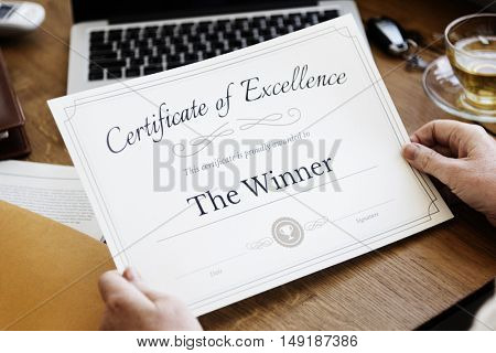 Senior Adult Holding Certificate Concept