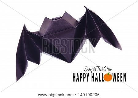 Origami paper halloween flying bat on a white background