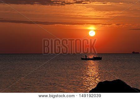 Fisherman at sunrise in Burgas bay, Bulgaria