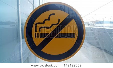 No Smoking Sign on Wet Window. Raining Day