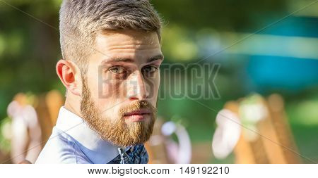 Portrait of Serious young bearded man outdoor