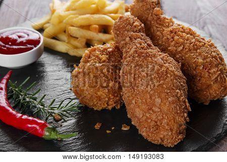 Breaded crispy chicken leg fried french fries sauce