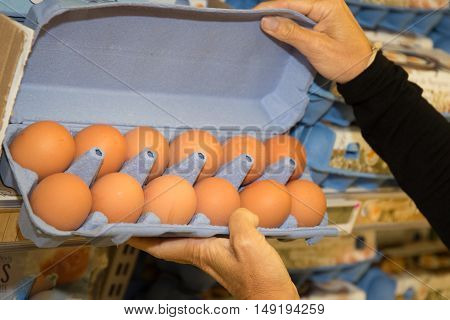 Woman Holding Free Range Eggs At Supermarket