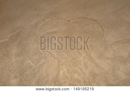 Heart Drawn In The Sand. Beach Background. Top View