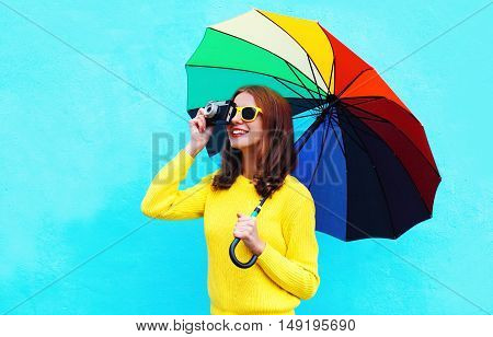 Happy Smiling Young Woman Holding Colorful Umbrella Taking Picture On Vintage Camera In Autumn Day O