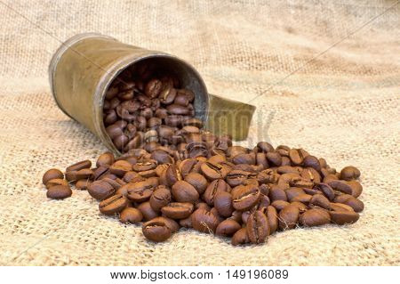 Coffee beans on vintage background. Delective focus.
