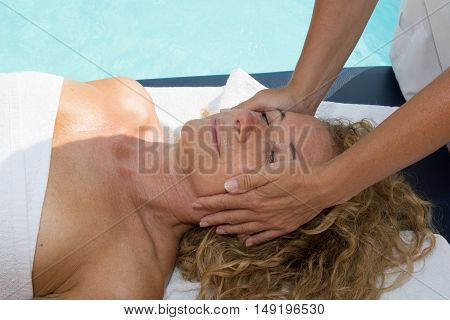 Blond Bright Woman Receiving A Head Massage In A Spa Center