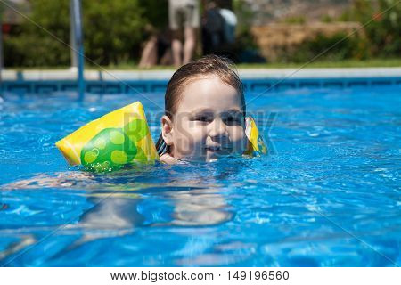 Looking Child With Sleeves In Pool