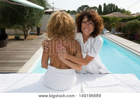 Female Physiotherapist Stretching Woman's Arm During Rehabilitation At Spa