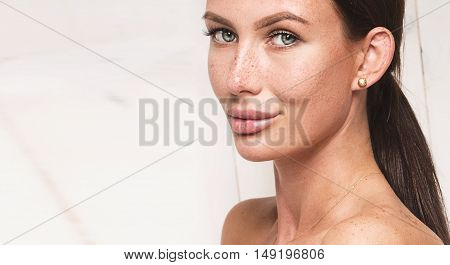 Natural Brunette Woman With Freckles On Face.