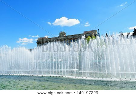 ST PETERSBURG RUSSIA -MAY 23 2015. The House of Soviets on the Moscow square and the singing fountain on the foreground in St Petersburg Russia. Architecture landmark of St Petersburg Russia