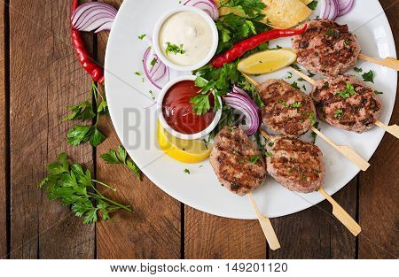 Appetizing Kofta Kebab (meatballs) With Sauce And Tortillas Tacos On A White Plate. Top View