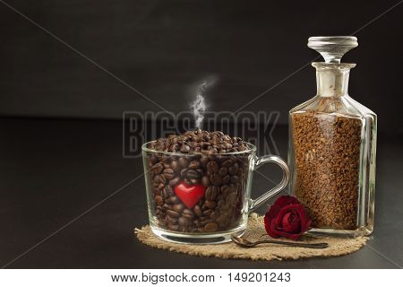 Granules of instant coffee background. Instant coffee in a glass dish. Preparation of soluble coffee. Decorate store coffee.