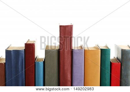 Old books on a white background, close up