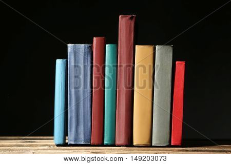 Old antique books on brown wooden table