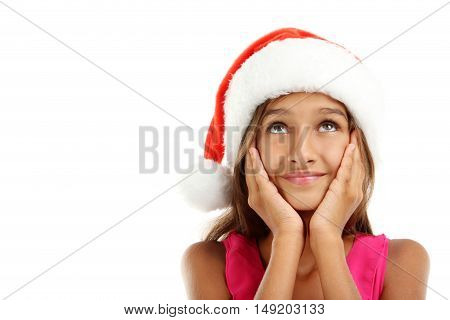 Portrait of young girl in santa hat