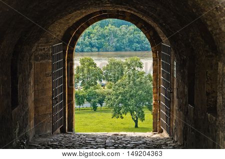 Beautiful view from arched passage. Medieval castle with arch.