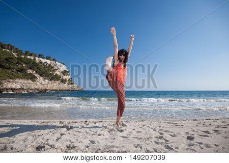Happy Woman Leg Up In Trebaluger Beach Minorca