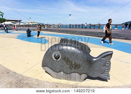 Kota Kinabalu, Malaysia - September 01, 2016: People Passing By The Dolphin Statue At Kota Kinabalu