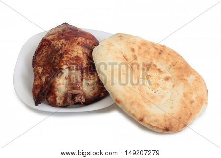 Piece of raw chicken meat and  bread on white background