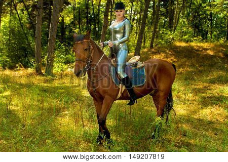 Image of a beautiful girl in uniform on horseback