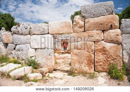 Tourist Walking In Prehistoric Town In Minorca