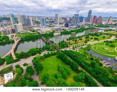Aerial Over Austin Green Spring Paradise over Auditorium Shores Park with Downtown Skyline Cityscape across on the North Side of the Colorado River