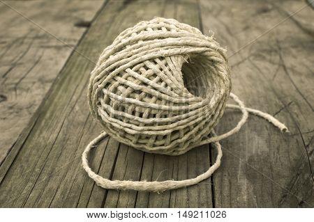 Hemp rope roll gunny on wooden background