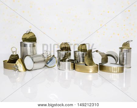 tin cans of conserved food ready to recycle on white background